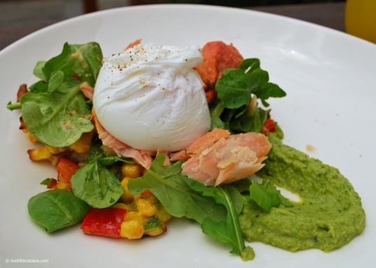 Corn fritters with poached egg, beetroot cured salmon and pea and basil mash