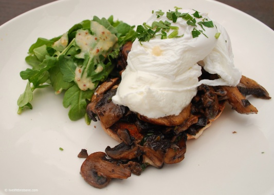 Garlic mushroom bruschetta with goat's curd and poached eggs